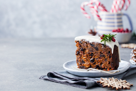 Christmas fruit cake, pudding on white plate. Traditional New Year dessert. Close up. Stock Photo