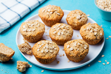 Healthy vegan oat muffins, apple and banana cakes with on a white plate.