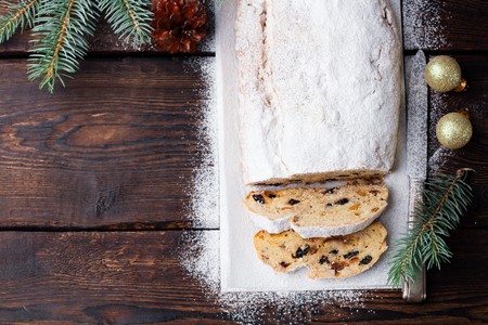 Christmas stollen cake with icing sugar.