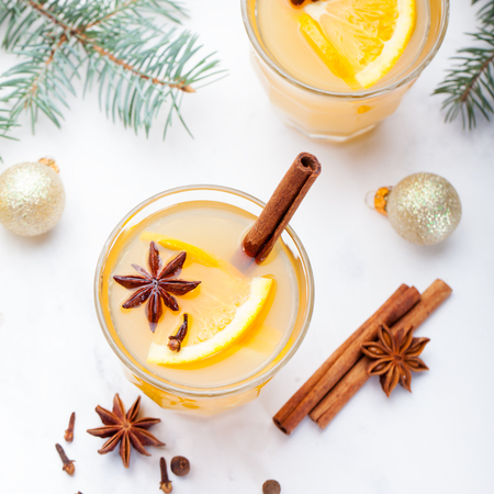 Mulled white wine with spices, orange slices on New year and Christmas