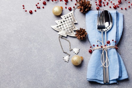 Christmas and New Year holiday table setting. Celebration place setting for dinner decorations. Stock Photo