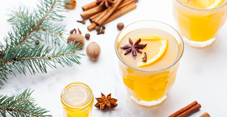 Mulled white wine with spices, orange slices.