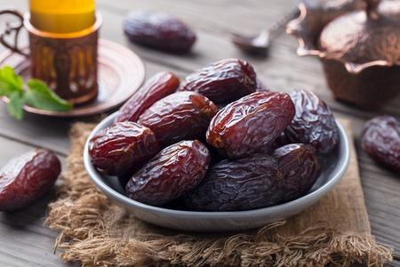 Fresh Medjool Dates in a bowl with tea. Ramadan kareem. Stockfoto