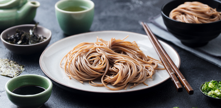 Soba noodles with sauce and green tea set. Japanese food.