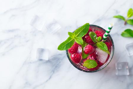Raspberry cocktail, fizz, lemonade, ice tea with fresh mint on marble