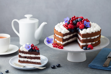 Chocolate cake with whipped cream and fresh berries.