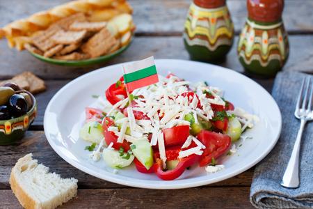 Vegetable Bulgarian shopska salad with Bulgaria flag.