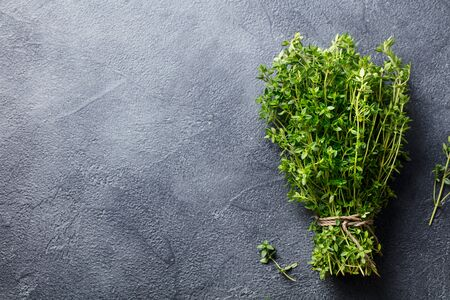 Fresh thyme bunch on slate background. Top view. Copy space.