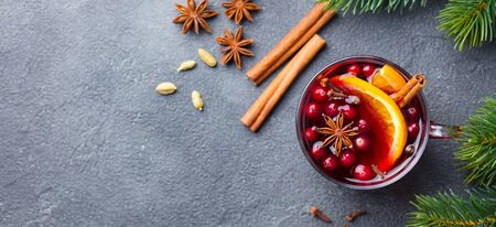 Mulled red wine with spices. Christmas decoration. Grey background. Copy space. Top view. Stock Photo