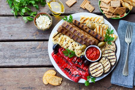 Traditional middle eastern, arabic or mediterranean meat kebab with grilled vegetables. Copy space. Top view.