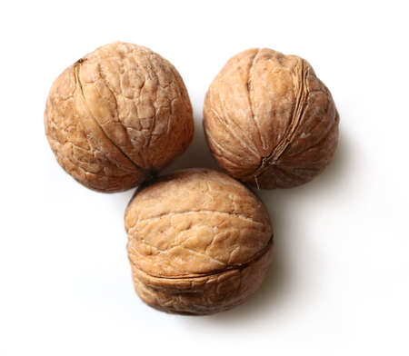 Three walnuts on white background Stock Photo
