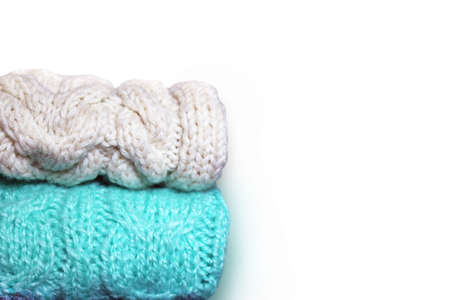 White and turquoise knitted textile on white background