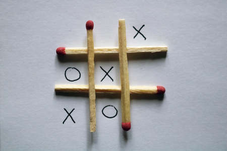 Image of playing tic-tac-toe with matches