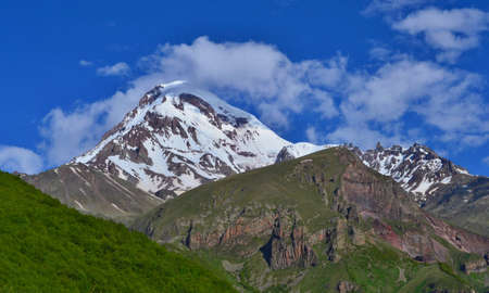 Beautiful Kazbek Mountain near Stepantsminda town. Georgian Valley.