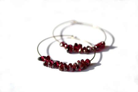 Hoop earrings with purple garnet gemstone, jewelry. Stock Photo