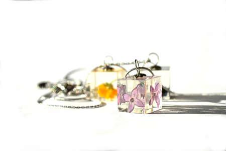 Beautiful epoxy resin jewelry. Cube-shaped handmade pendant. Stockfoto