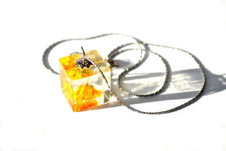 Beautiful epoxy resin jewelry. Cube-shaped handmade pendant.