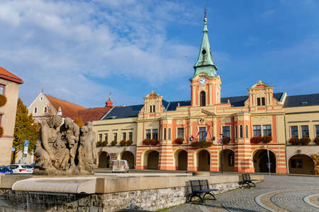 Baroque town hall and modern fountain at main Peace square of historic medieval royal town Melnik, colorful renaissance houses in sunny autumn day, Central Bohemia, Czech republic, November 14, 2020 Editorial