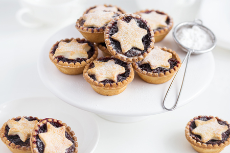 Fruit mince tarts for Christmas dinner. White background, selective focus Stock Photo