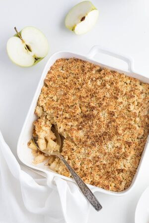 apple crumble pie in white baking dish, top view