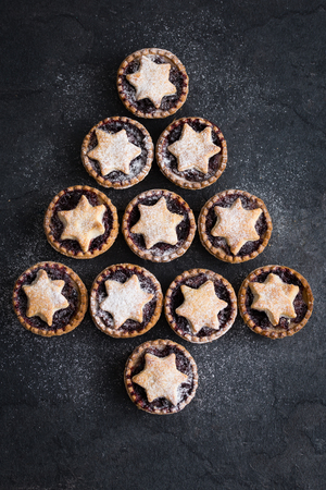 Delicious fruit mince tarts for Christmas. Dark  background, top view