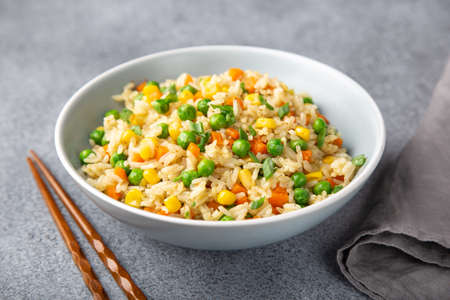 rice with vegetables in bowl, selective focus