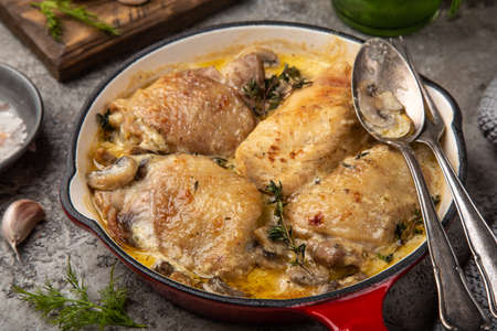 roasted chicken with mushroom in cream garlic sause on pan, top view,