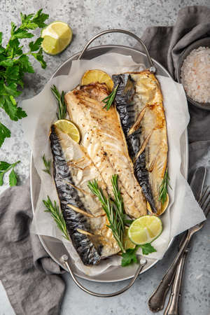 oven baked mackerel, gray background, top view