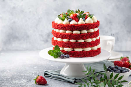 festive Red Velvet cake on white cake stand, selective focus, copy space