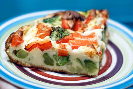 Slice of light Greek vegetable pie with cheese, broccoli and red pepper