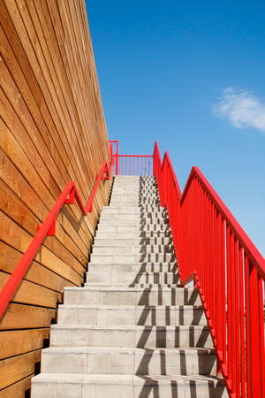 Stairway to heaven with red railing. Business and career growth