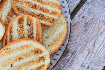 Grilled bread on a wooden table. Healthy breakfast