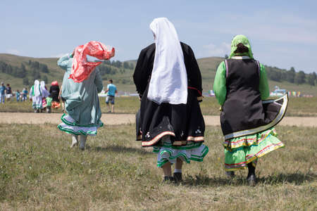 06.23.2019 Russia, Bashkortostan: Women in Bashkir ethnic costume at Sabantuy holiday