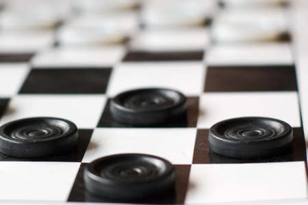 Checkers artboard. Blacks and whites ready to start the new game.