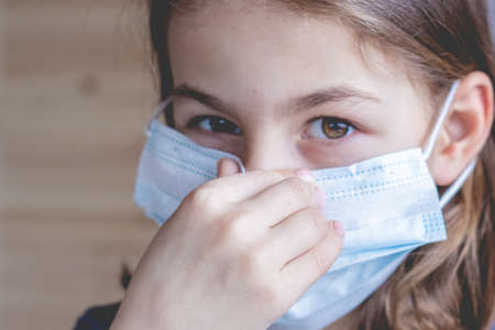 Portrait of a girl in a medical mask