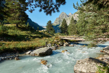 Mountain river landscape. Alps. In the morning in clear sunny day on a wide corner. The river quickly flows. Mountaineering and hikes. Amazing. Around. Stock fotó