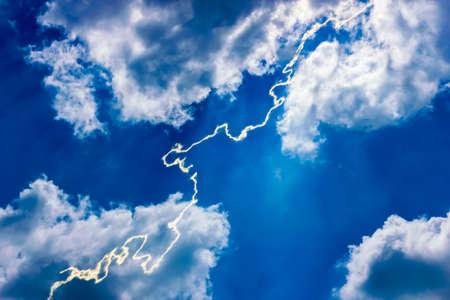 Lightning amid a dark blue sky. Cumulus clouds. A tropical storm warning. genius, gloomy, glow, glowing, god, heaven, hope, illumination Stock Photo