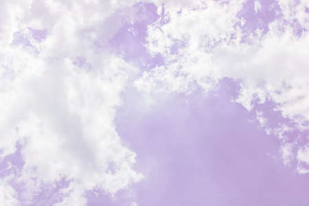 Fluffy white clouds on a pink background float in the sky. Dream. Femininity. Divine view. Background. Wallpaper. Concept pink glasses. affability, friendliness, amiability. copy space