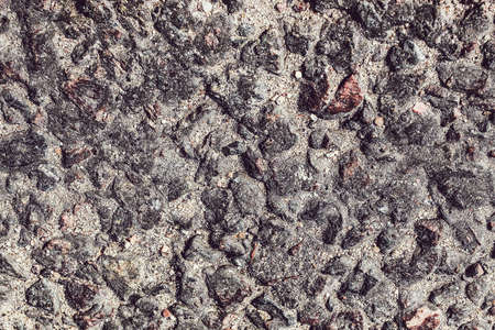 Solid granite stones lying on the sand road highway where passing cars. Road works. color, decoration, design, empty, gravel