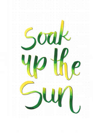 Soak up the sun happy hand lettering saying to motivate people to go outside in summer