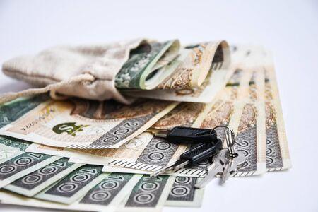 polish zloty currency, poland money, and keys, one hundred zloty copy space businnes money