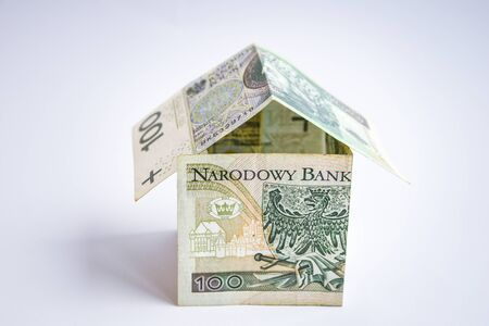 polish zloty currency, poland money, one hundred zloty copy space, money in the shape of house, saving earnings Stock Photo