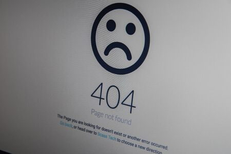 Computer 404 error failure concept, failure message on screen, bad software pc app crash, email malware, data loss and recovery, rear view over the shoulder Business laptop or office notebook computer PC Stock Photo