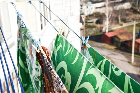 Waschespinne, Hung up to Dry, Clothes dry on a rope in the balcony, laundry pins and hanged clothes, 版權商用圖片