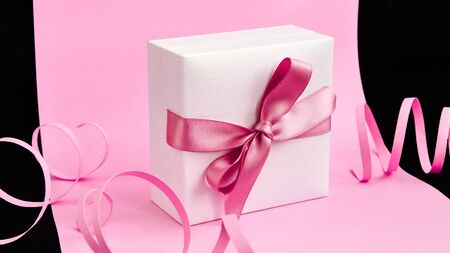 Present box with pink ribbon on the pink and black background, Holiday, Gifts, Copy space, Greeting card