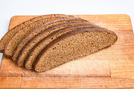 rye bread slices on the wooden board in the white background isolated