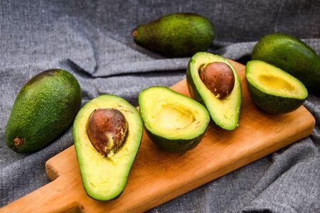 slices avocado. Avocado Salad Recipe food background with fresh organic avocado
