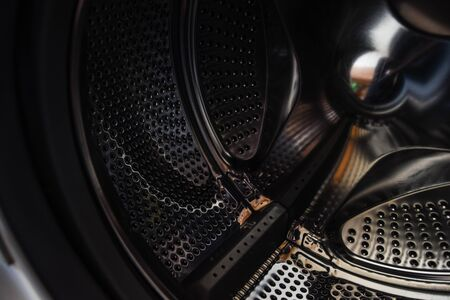 drum washing machine, close-up, closeup image of washing machine, abstract metallic texture