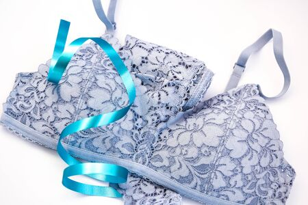 Elegant light blue women's underwear isolated on white, shadows, lacy lingerie womens underwear on white background