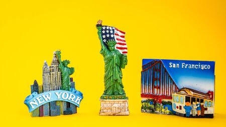 USA with magnets from new york and san francisco on yellow background, travel destination, America travel